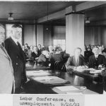 Herbert Hoover and Secretary of Labor James J. Davis, half-length portrait, standing, facing right, at labor conference on unemployment
